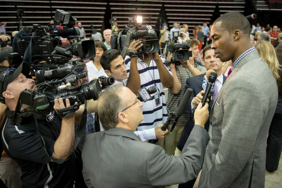 Dwight Howard is interview by a group of media. Photo: Smiley N. Pool, Houston Chronicle