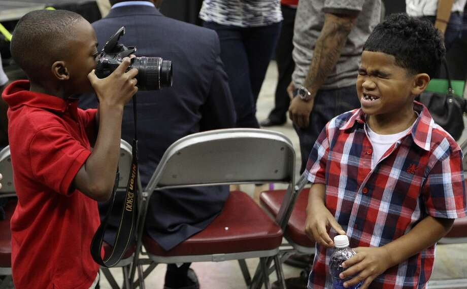 Braylon Howard, 5, Dwight Howard's son, takes a photo of family friend, Jayden Felder, 5. Photo: Karen Warren, Houston Chronicle