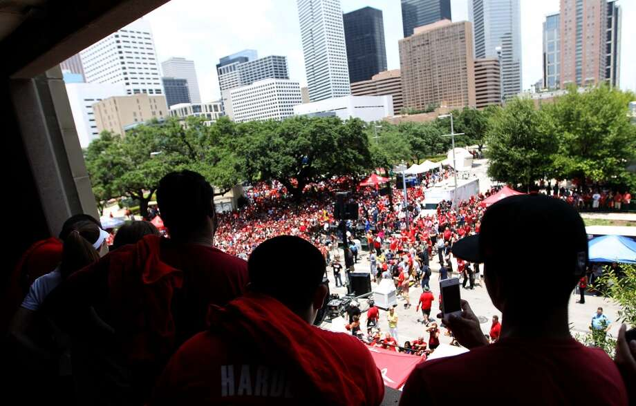Houston Rockets fans take photos from the parking garage. Photo: Karen Warren, Houston Chronicle