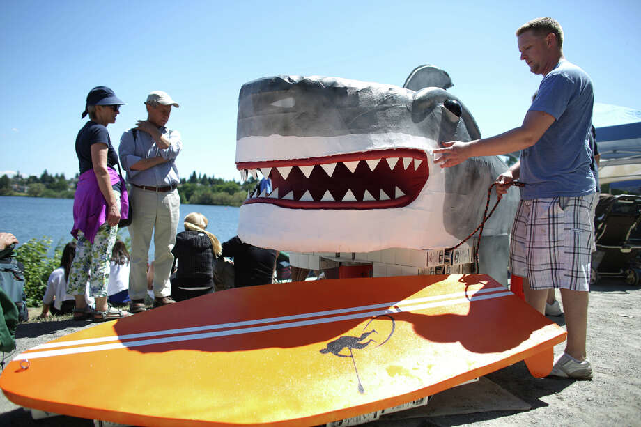 Ben Connor helps carry a shark boat. Photo: JOSHUA TRUJILLO, SEATTLEPI.COM