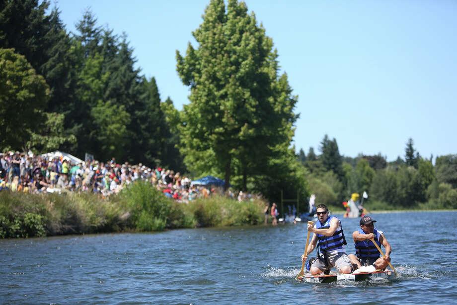 Competitor paddle to the finish line. Photo: JOSHUA TRUJILLO, SEATTLEPI.COM