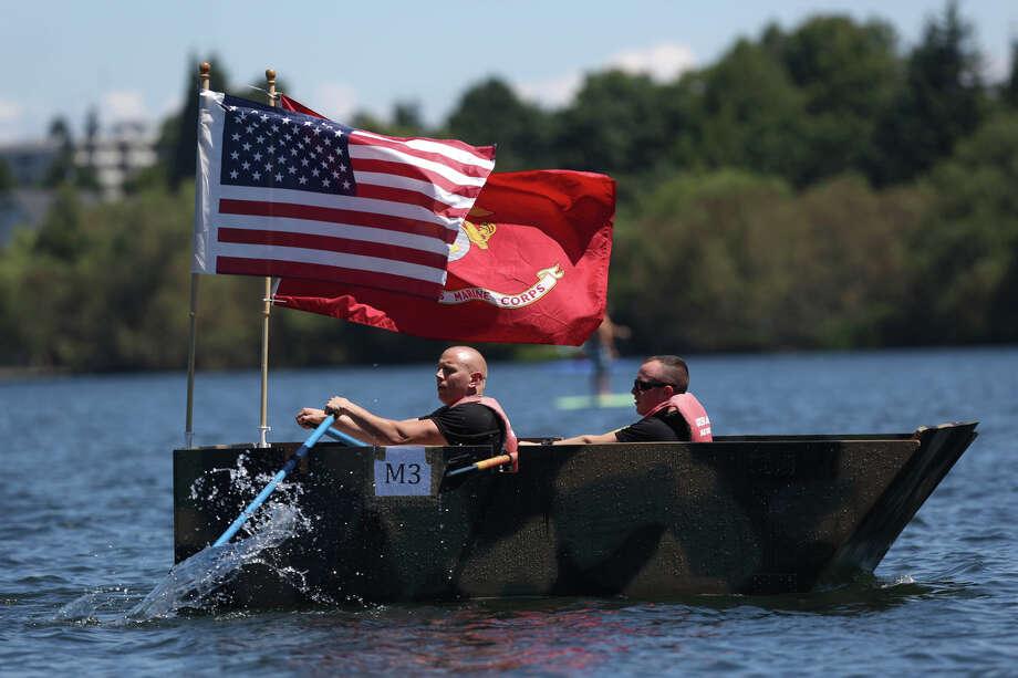 Members of the U.S. Marines entry paddle. Photo: JOSHUA TRUJILLO, SEATTLEPI.COM