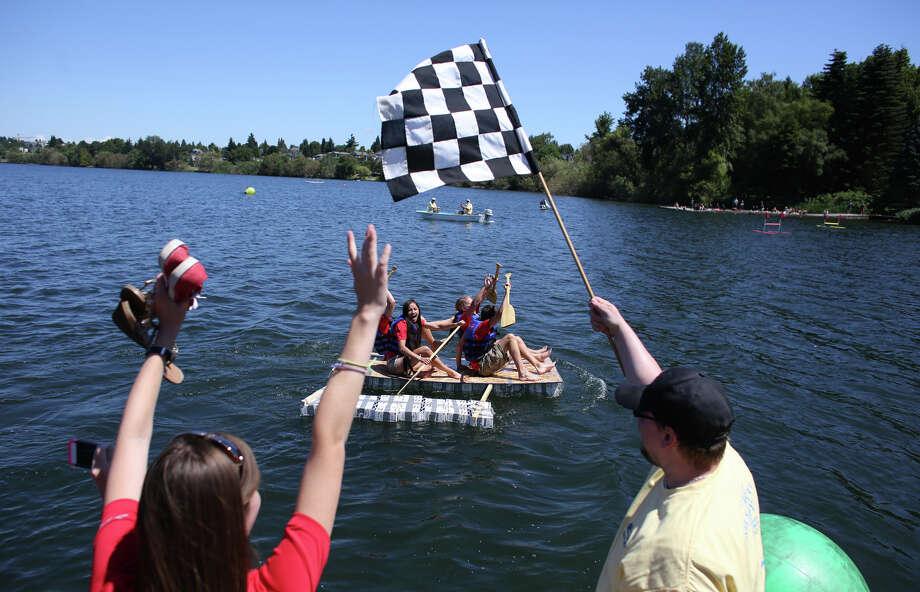 The Seafair Ambassadors boat crosses the finish. Photo: JOSHUA TRUJILLO, SEATTLEPI.COM