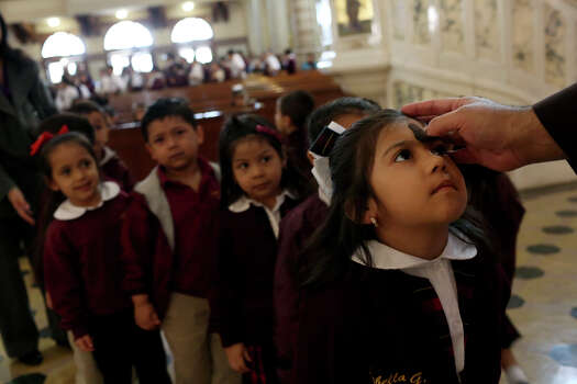 Isabella Galan, 4, receives ashes with fellow students from the Little Flower Catholic School during the Ash Wednesday Mass at the Basilica of the National Shrine of the Little Flower in San Antonio on Wednesday, Feb. 13, 2013. Waiting behind her are fellow Pre-Kindergarten (4-year-olds) students Addison Becerra, from left, Matthew Salguero and Khloe Herrera. Photo: Lisa Krantz, San Antonio Express-News / © 2012 San Antonio Express-News