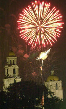 The Basilica of the National Shrine of Little Flower steeples frame the fireworks display at Woodlawn Lake on July 4, 2003. Photo: JOE BARRERA JR., San Antonio Express-News / SAN ANTONIO EXPRESS-NEWS