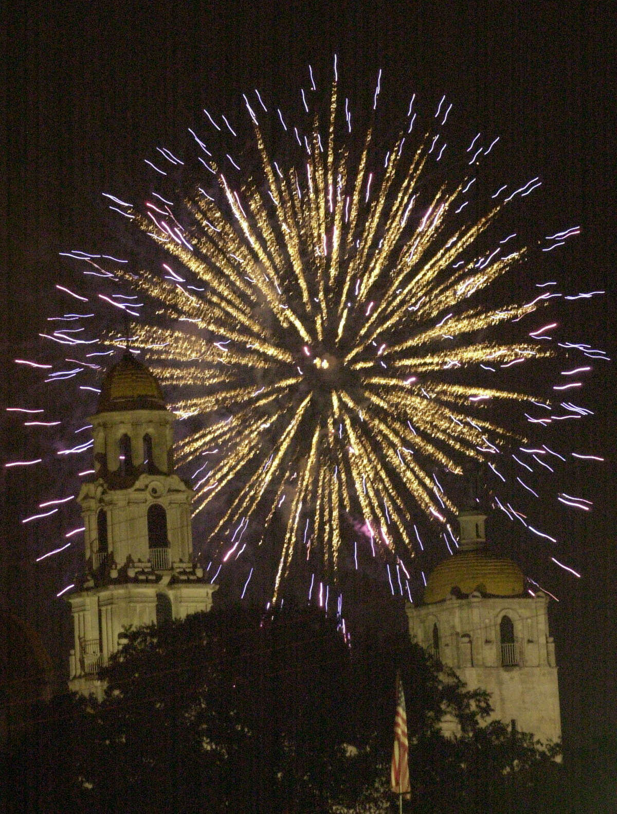 The Basilica of the National Shrine of Little Flower steeples frame the fireworks display at Woodlawn Lake on July 4, 2003.