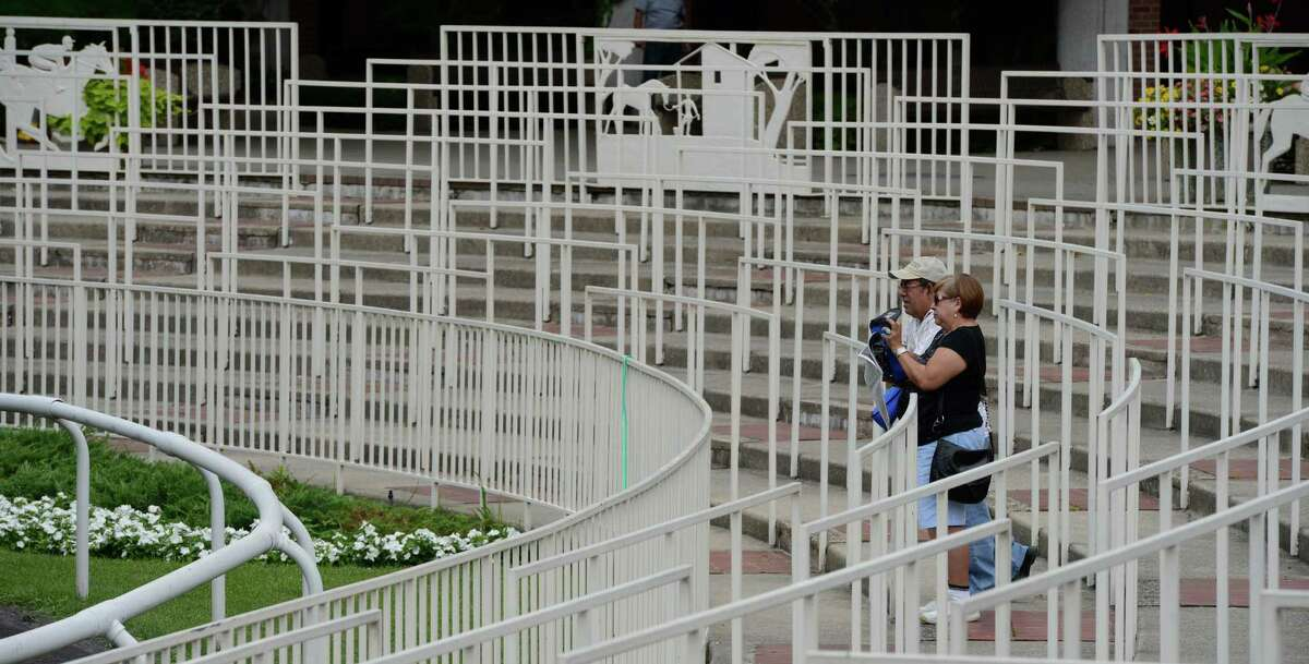 Race patrons arrive early for the first race on the card at Belmont Park Thursday afternoon, July 11, 2013, in Elmont, N.Y. ( Skip Dickstein/Times Union )