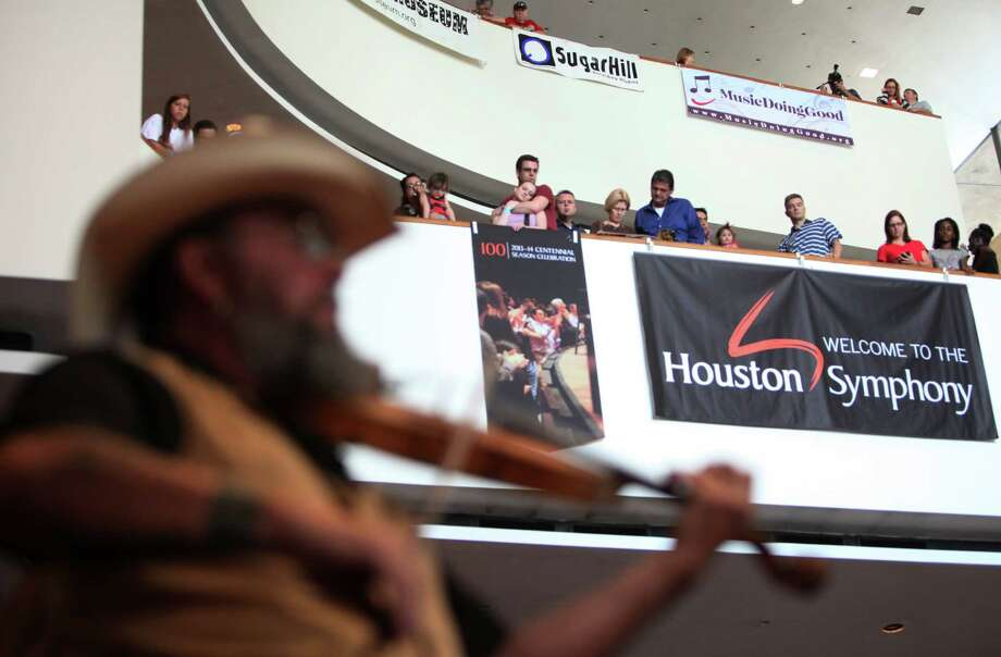 The audience listens to the Texas style celtic rock group Clandestine as they perform during 'Day of Music' at Jones Hall during the Symphony's Centennial Season on Saturday, July 13, 2013, in Houston. Photo: Mayra Beltran / © 2013 Houston Chronicle