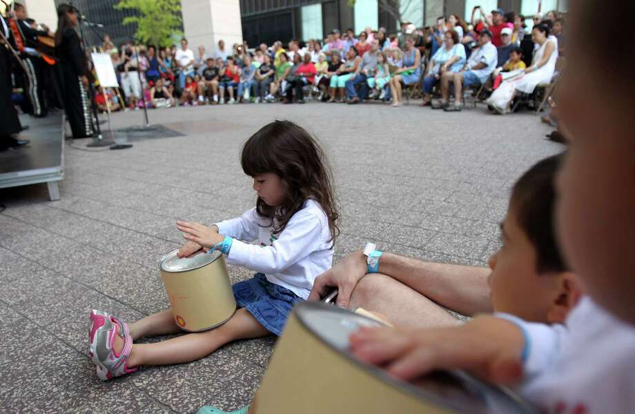 Luke Smith, 5, plays a drum made in arts and crafts activity as they wait to hear music by Mariachi MECA will perform during 'Day of Music' at Jones Hall on Saturday, July 13, 2013, in Houston. Photo: Mayra Beltran / © 2013 Houston Chronicle