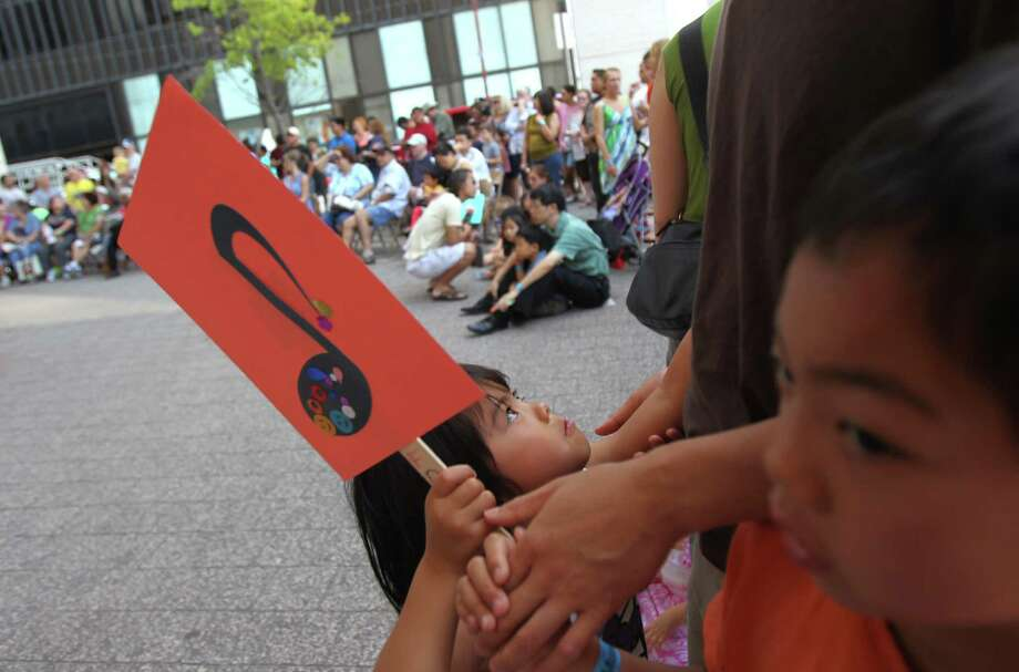 Frances Lai, 4, turns to her father as they wait for more performers during 'Day of Music' at Jones Hall on Saturday, July 13, 2013, in Houston. Photo: Mayra Beltran / © 2013 Houston Chronicle