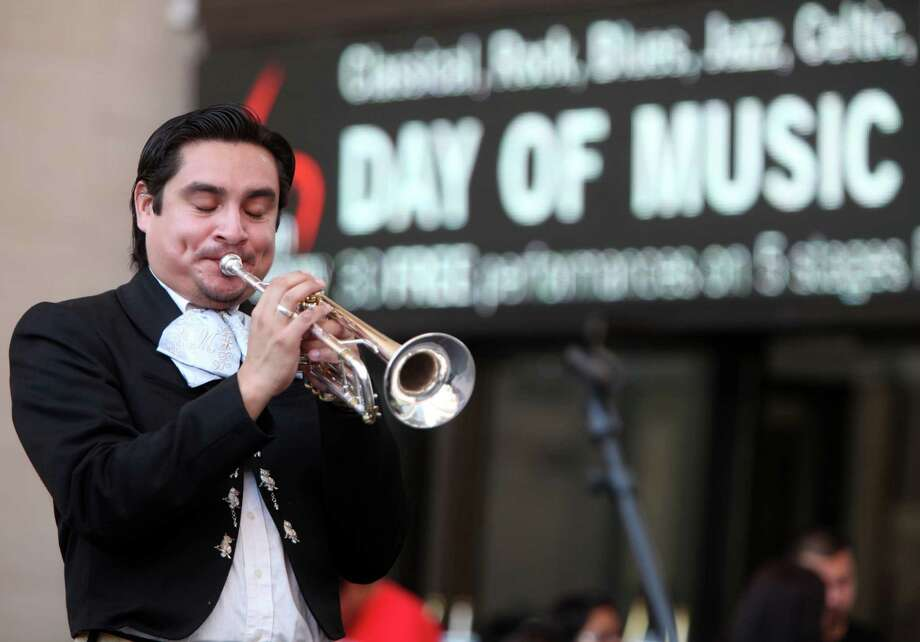 Nelson Ulloa plays with Mariachi Autlan, who are alumns from Mariachi MECA, in the outside patio stage during 'Day of Music' at Jones Hall on Saturday, July 13, 2013, in Houston. Photo: Mayra Beltran / © 2013 Houston Chronicle