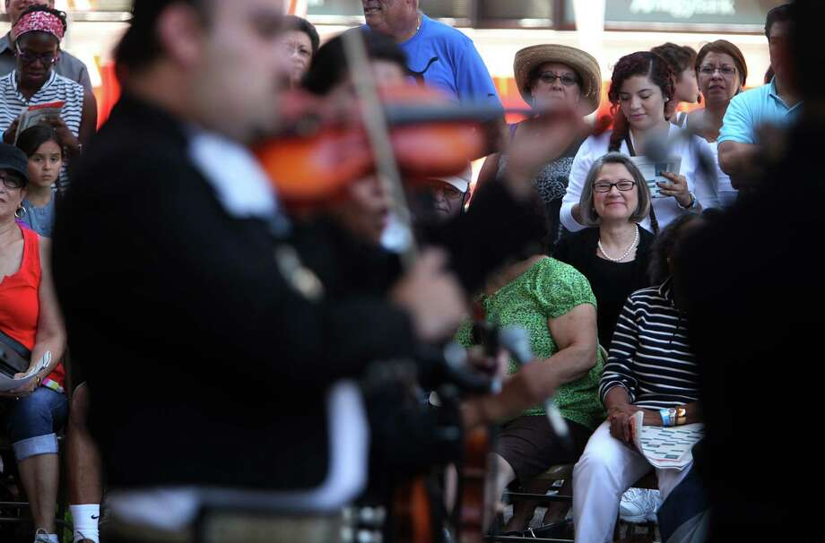The crowd enjoys sounds from Mariachi Autlan, who are alumns from Mariachi MECA, as they perform in the outside patio stage during 'Day of Music' at Jones Hall on Saturday, July 13, 2013, in Houston. Photo: Mayra Beltran / © 2013 Houston Chronicle