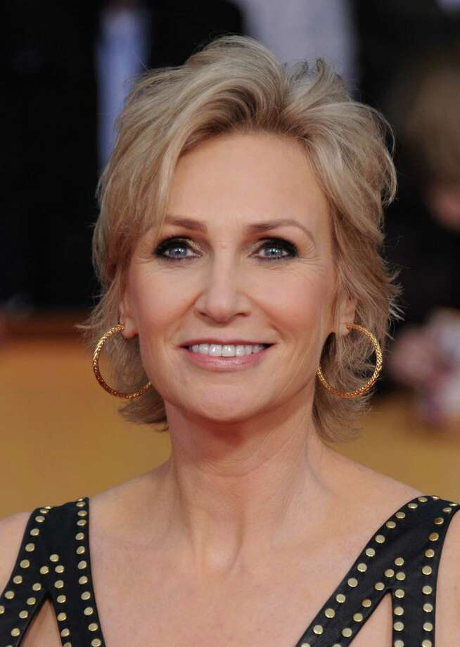 Jane Lynch arrives at the 19th Annual Screen Actors Guild Awards at the Shrine Auditorium in Los Angeles on Sunday Jan. 27, 2013. (Photo by Jordan Strauss/Invision/AP) Photo: Jordan Strauss / Invision