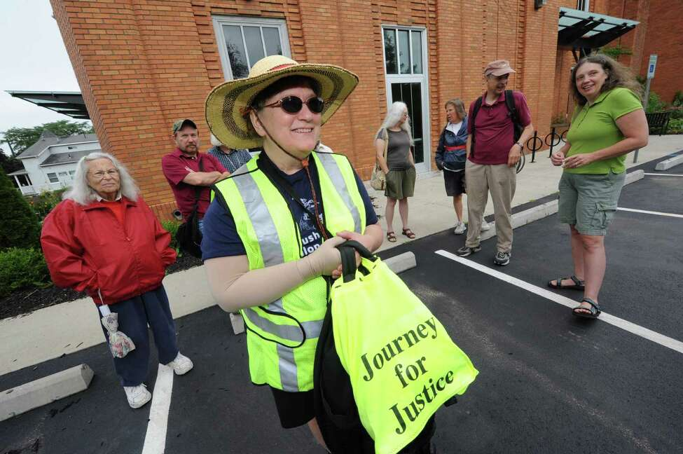Lynne Jackson, center, and her supporters, as Jackson sets out on 133 mile walk from Albany to Binghamton to deliver a motion for retrial for imprisoned Albany imam, Yassin Aref, to home court of federal judge on Saturday July 13, 2013 in Albany, N.Y. (Michael P. Farrell/Times Union)