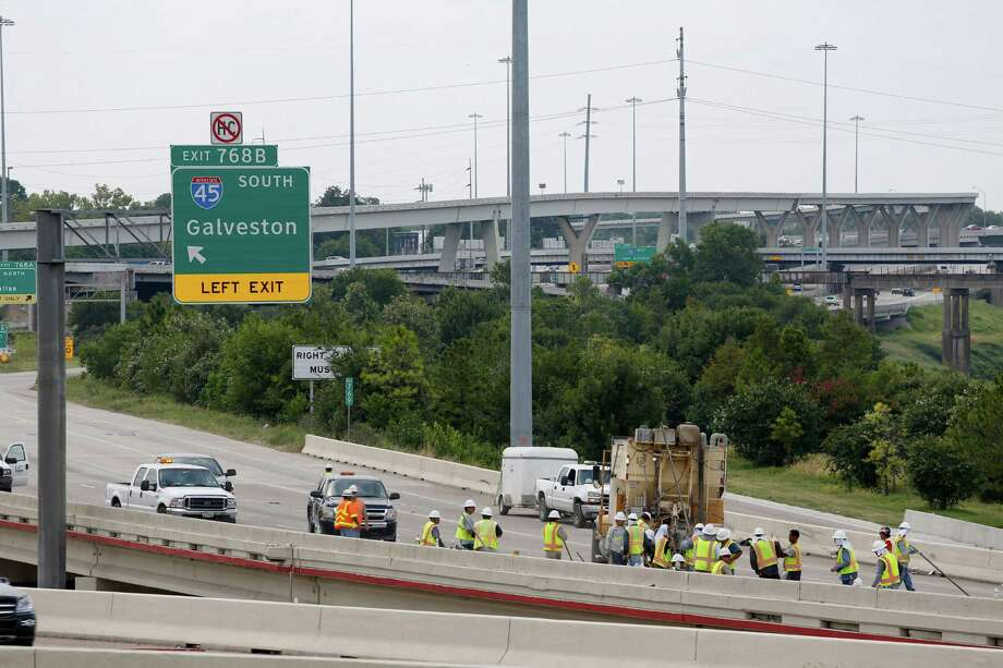 Workers repair a section of IH-10 just north of downtown that was damaged yesterday by an overturned semi trailer, July 13, 2013 in Houston. Photo: Eric Kayne / ©2013 Eric Kayne