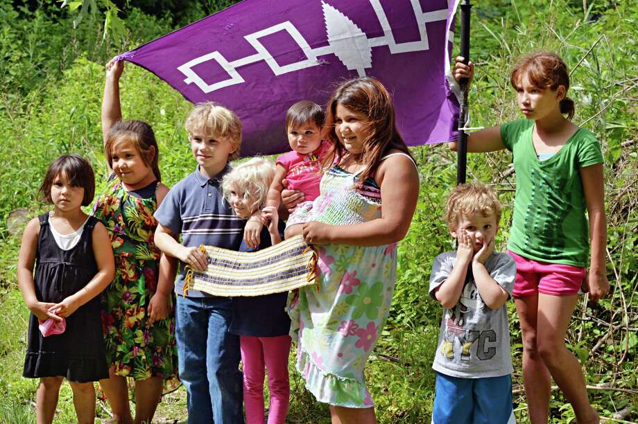 Native and non-native children, from left Haley Shenandoah, 4, Raelyn Shenandoah, 6, Alexander Cundiff,8, Kaia Cundiff, 5, Cassidy Shenandoah, 10 months, Leighann Shenandoah, 8, Cameron Czajkowski, 3, and Dylan Halbritter,10, pose with Two Row Wampum belt during the Two Row Festival Schenectady at the Mabee Farm in Rotterdam Junction, NY Saturday July 13, 2013.  The Shenandoah's and  Halbritter are from the Onondaga Nation, the Cundiff's are from Tampa, Florida and Cameron is from Rotterdam.  (John Carl D'Annibale / Times Union) Photo: John Carl D'Annibale / 00023037A