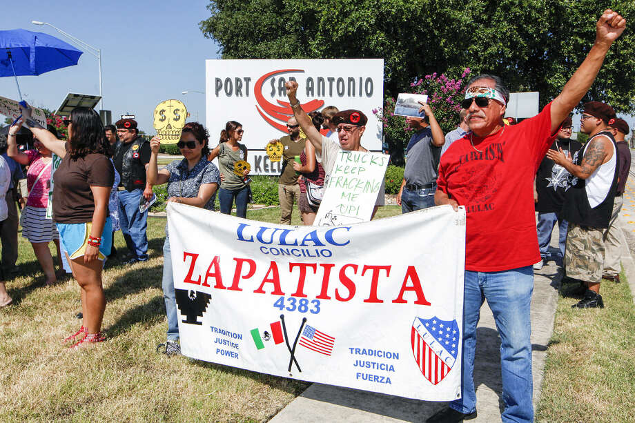 Rally participants are displeased because the group overseeing the cleanup of the former Air Force base was disbanded. Photo: Photos By Marvin Pfeiffer / San Antonio Express-News
