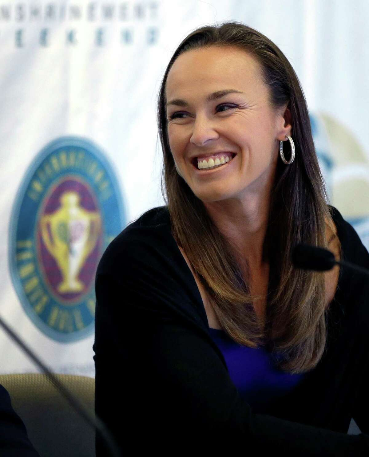 Tennis great Martina Hingis, of Switzerland, smiles during a news conference prior to her enshrinement into the International Tennis Hall of Fame in Newport, R.I. on Saturday, July 13, 2013. (AP Photo/Elise Amendola) ORG XMIT: RIEA101