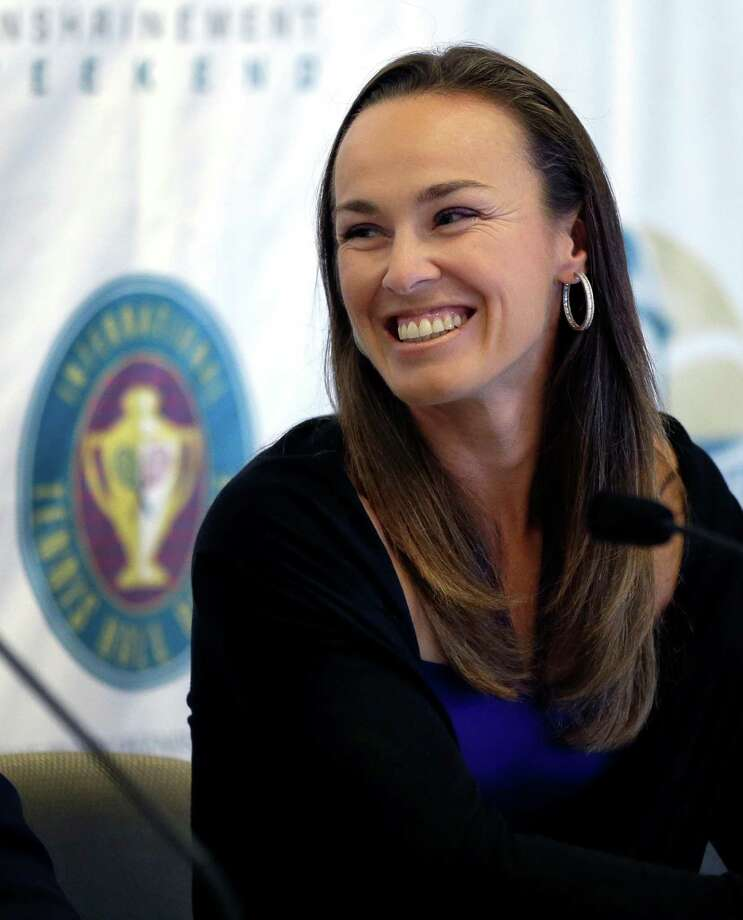Tennis great Martina Hingis, of Switzerland, smiles during a news conference prior to her enshrinement into the International Tennis Hall of Fame in Newport, R.I. on Saturday, July 13, 2013. (AP Photo/Elise Amendola) ORG XMIT: RIEA101 Photo: Elise Amendola / AP
