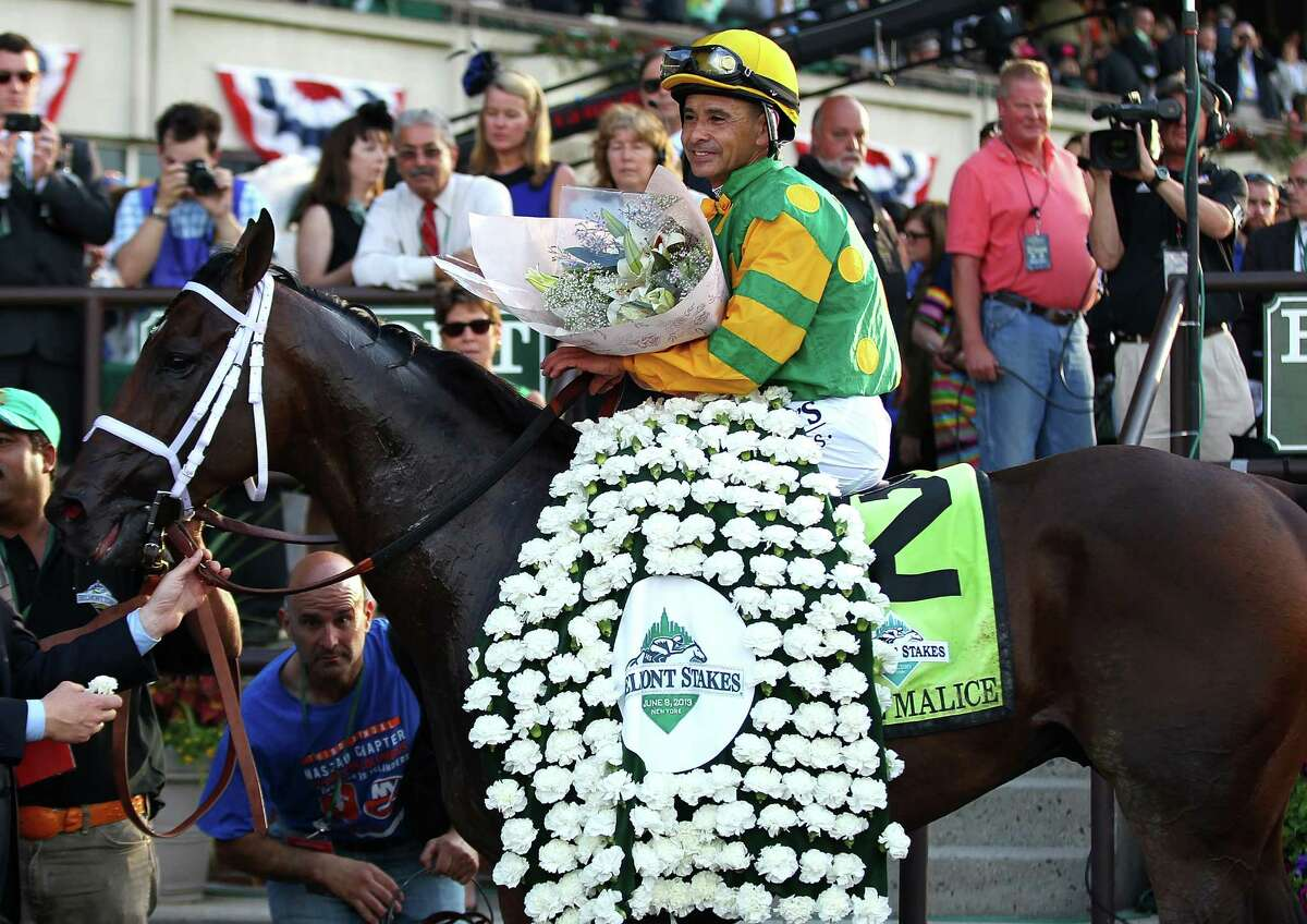 ELMONT, NY - JUNE 08: Jockey Mike Smith sits abourd Palace Malice in the winners circle after winning the 145th running of the Belmont Stakes at Belmont Park on June 8, 2013 in Elmont, New York. (Photo by Mike Stobe/Getty Images)