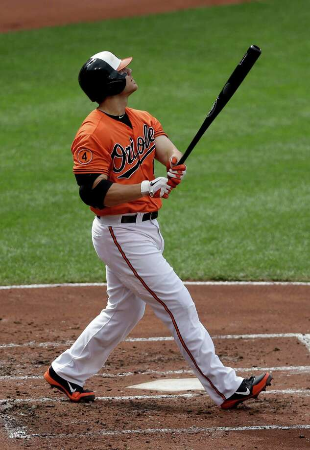 Baltimore Orioles' Chris Davis watches his solo home run in the second inning of a baseball game against the Toronto Blue Jays, Saturday, July 13, 2013, in Baltimore. (AP Photo/Patrick Semansky) ORG XMIT: MDPS105 Photo: Patrick Semansky / AP