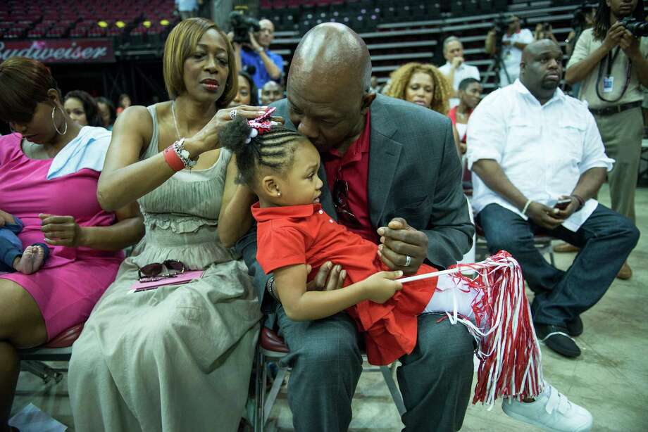 Dwight Howard's parents, Sheryl and Dwight Sr., recognized the toll that drama-filled seasons in Orlando and Los Angeles took on him. They showed their support for his decision to join the Rockets by attending his introduction along with his daughter Layla, 3. Photo: Smiley N. Pool, Staff / © 2013  Houston Chronicle
