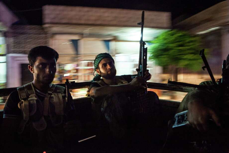 Rebels travel to northwestern Syria last week. Rebels affiliated with the Free Syrian Army and fighters from the Islamic State of Iraq and the Levant have been battling against each other. Photo: Daniel Leal-Olivas / AFP / Getty Images