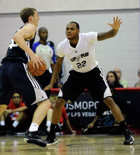 Spurs rookie Deshaun Thomas (right) scored 18 points in his first summer league game. Photo: David Becker / Associated Press
