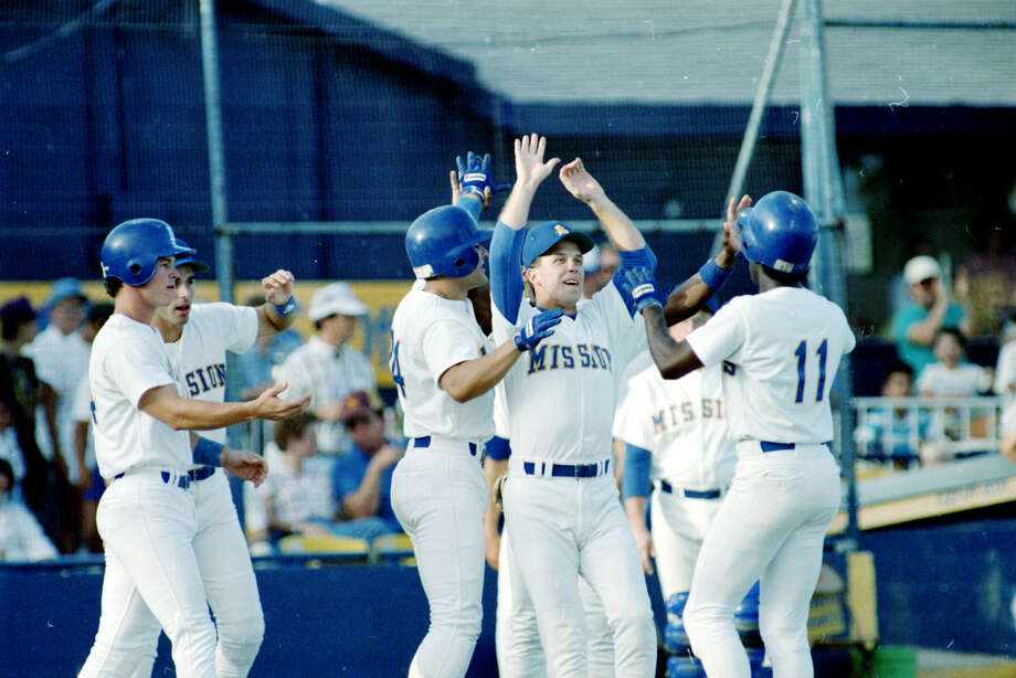 The Missions' Manny Francois (11) is greeted by teammates after his hit ended a 1-0, 26-inning marathon victory over the Jackson Mets on July 16, 1988, at V.J. Keefe Stadium — a game played over three days. Photo: San Antonio Express-News File Photo