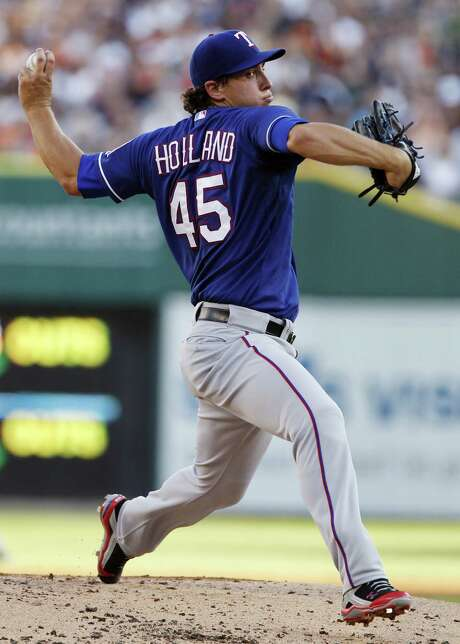 The Rangers' Derek Holland (8-4) allowed a run on five hits with seven strikeouts in seven innings as he outdueled the Tigers' Max Scherzer (13-1). Photo: Duane Burleson / Getty Images