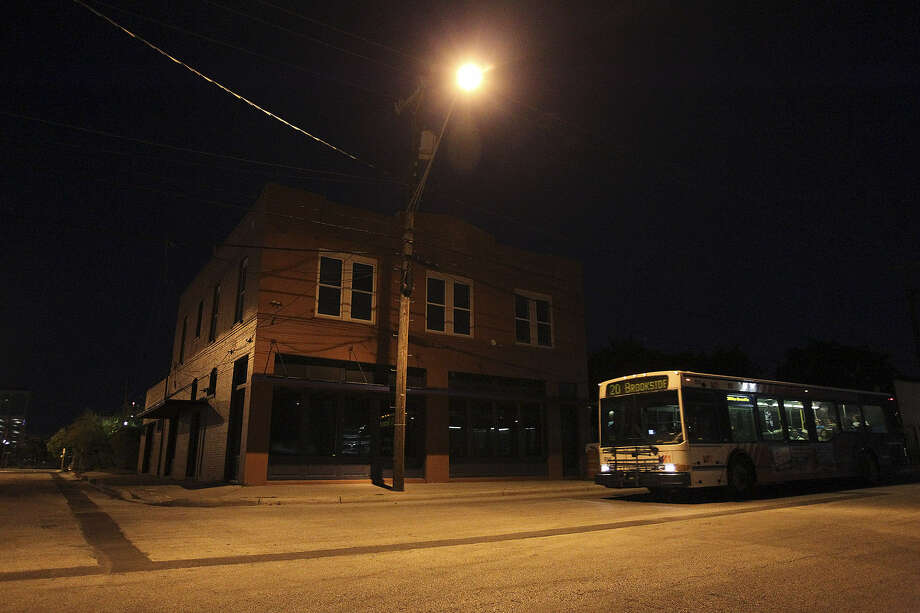 A VIA Metropolitan Transit bus heads north on North Medina Street in an area that now has a seedy atmosphere. Photo: Photos By Jerry Lara / San Antonio Express-News