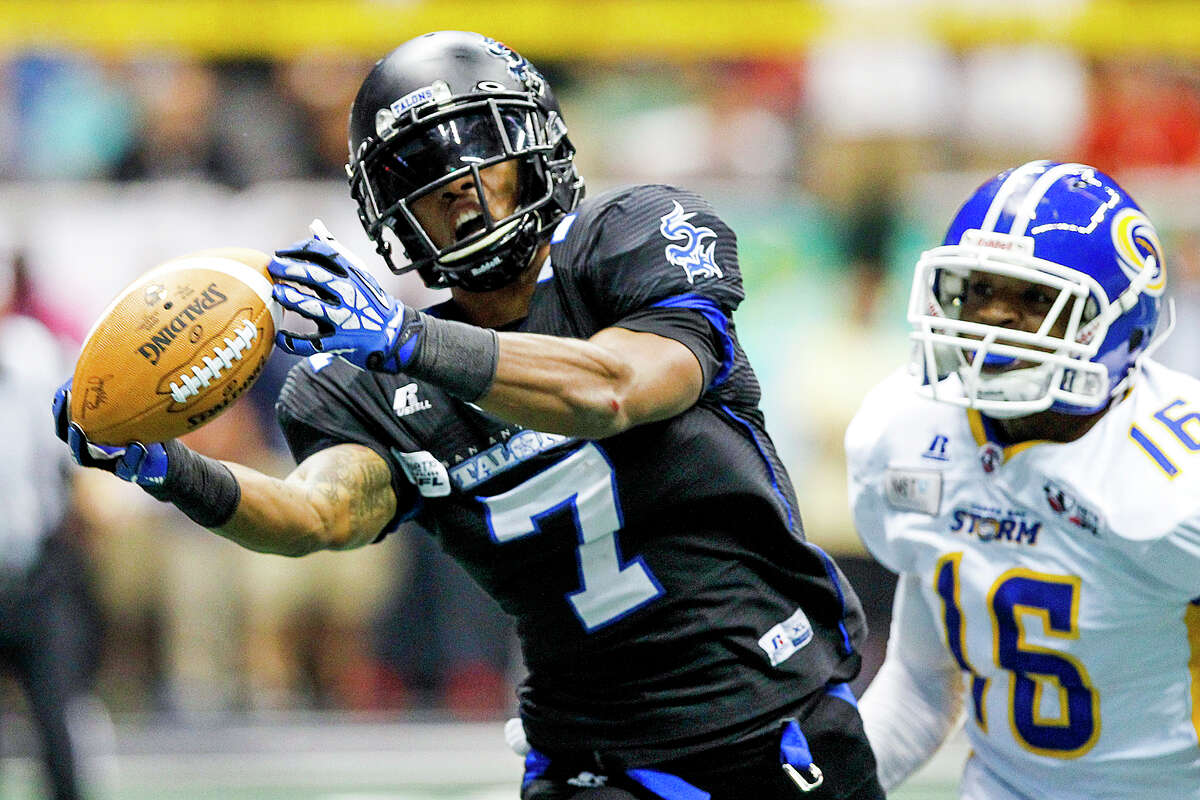 D.J. Stephens of the Talons makes a catch during the second quarter of their game with the Tampa Bay Storm at the Alamodome on Saturday, July 13, 2013. Stephens was denied a touchdown on the play when the ball was batted out of his hands before he crossed the end zone. Stephens had three touchdown receptions in the first half of the game. MARVIN PFEIFFER/ mpfeiffer@express-news.net