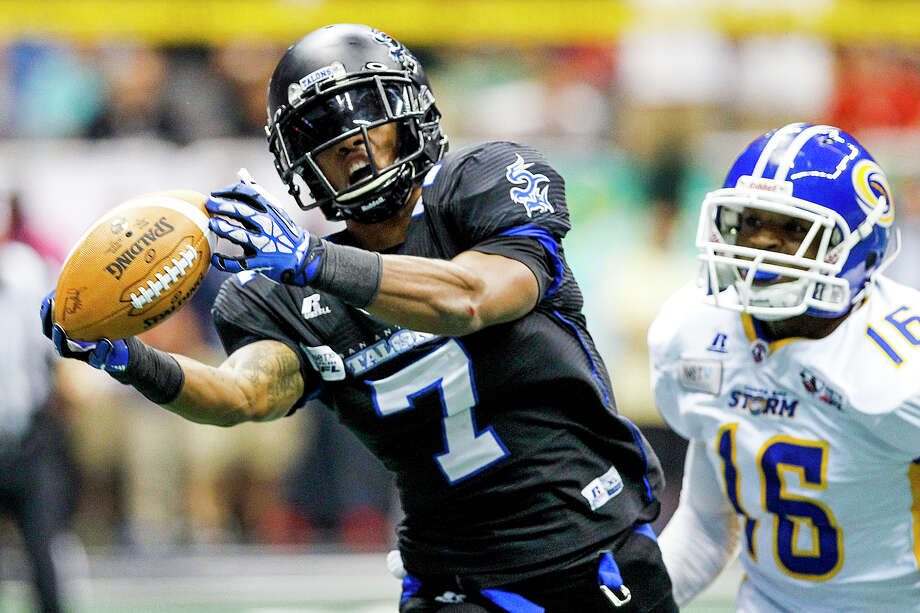 D.J. Stephens of the Talons makes a catch during the second quarter of their game with the Tampa Bay Storm at the Alamodome on Saturday, July 13, 2013.  Stephens was denied a touchdown on the play when the ball was batted out of his hands before he crossed the end zone.  Stephens had three touchdown receptions in the first half of the game.  MARVIN PFEIFFER/ mpfeiffer@express-news.net Photo: Marvin Pfeiffer, San Antonio Express-News / Express-News 2013