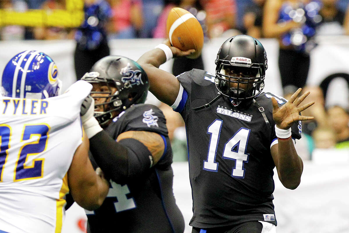 Talons quarterback Rohan Davey (right) prepares to throw a touchdown pass to D.J. Stephens during the first quarter of their game with the Tampa Bay Storm at the Alamodome on Saturday, July 13, 2013. MARVIN PFEIFFER/ mpfeiffer@express-news.net