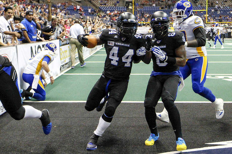 Jamar Ransom (44) scores on a 20-yard interception return in the second quarter, giving the Talons a 27-14 lead. Ransom, who led the Talons with six tackles, had one of three interceptions thrown by the Storm's Randy Hippeard, kneeling at the goal line. Photo: Marvin Pfeiffer / San Antonio Express-News