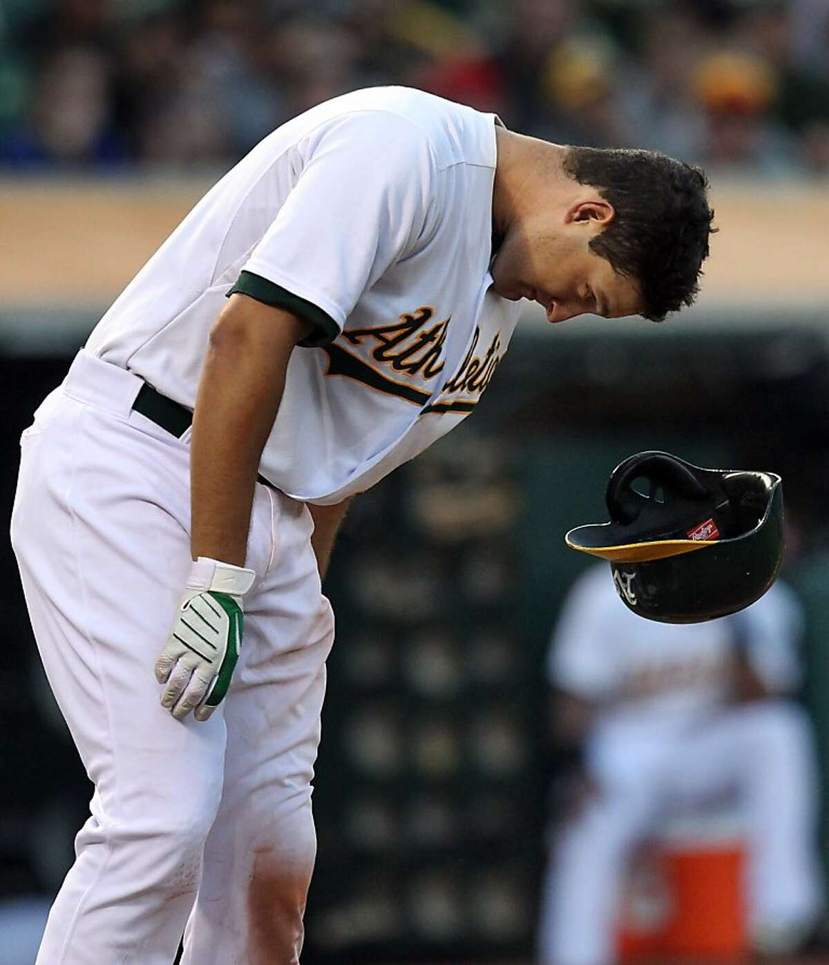 Oakland Athletics Nate Freiman reacts to striking out in the 4th inning of their MLB baseball game with the Boston Red Sox Saturday, July 13, 2013, In Oakland CA.