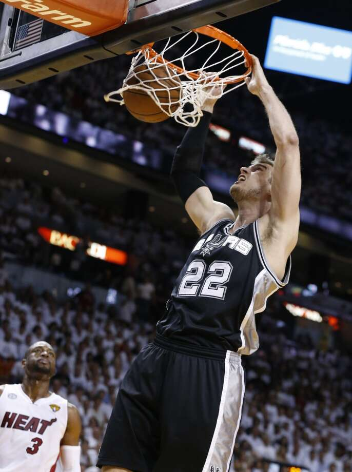 San Antonio Spurs' Tiago Splitter dunks during the first half of Game 7 of the 2013 NBA Finals Thursday, June 20, 2013 at American Airlines Arena in Miami. (Edward A. Ornelas/San Antonio Express-News)