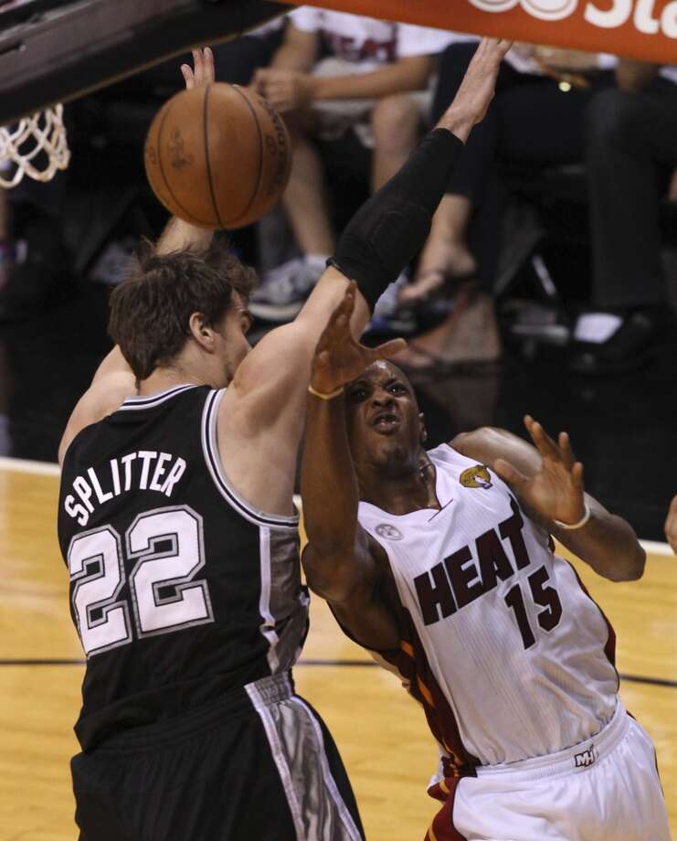 San Antonio Spurs' Tiago Splitter defends against Miami Heat's Mario Chalmers during the first half of Game 6 of the NBA Finals at American Airlines Arena on Tuesday, June 18, 2013 in Miami. (Kin Man Hui/San Antonio Express-News)