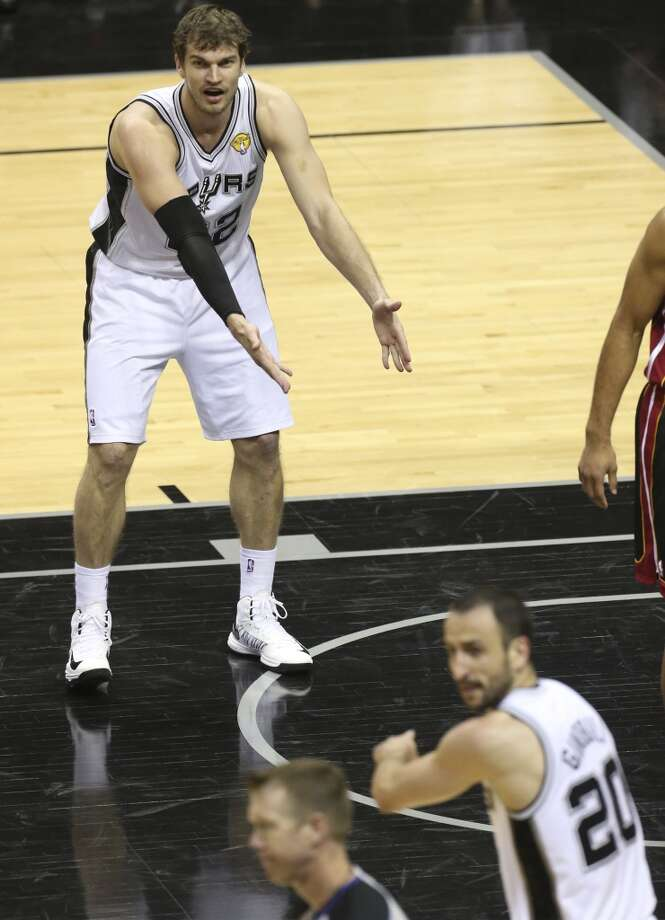 San Antonio Spurs' Tiago Splitter tries to argue a call with help from Manu Ginobili during the fist half of Game 5 of the NBA Finals at the AT&T Center on Sunday, June 16, 2013. (Jerry Lara/San Antonio Express-News)