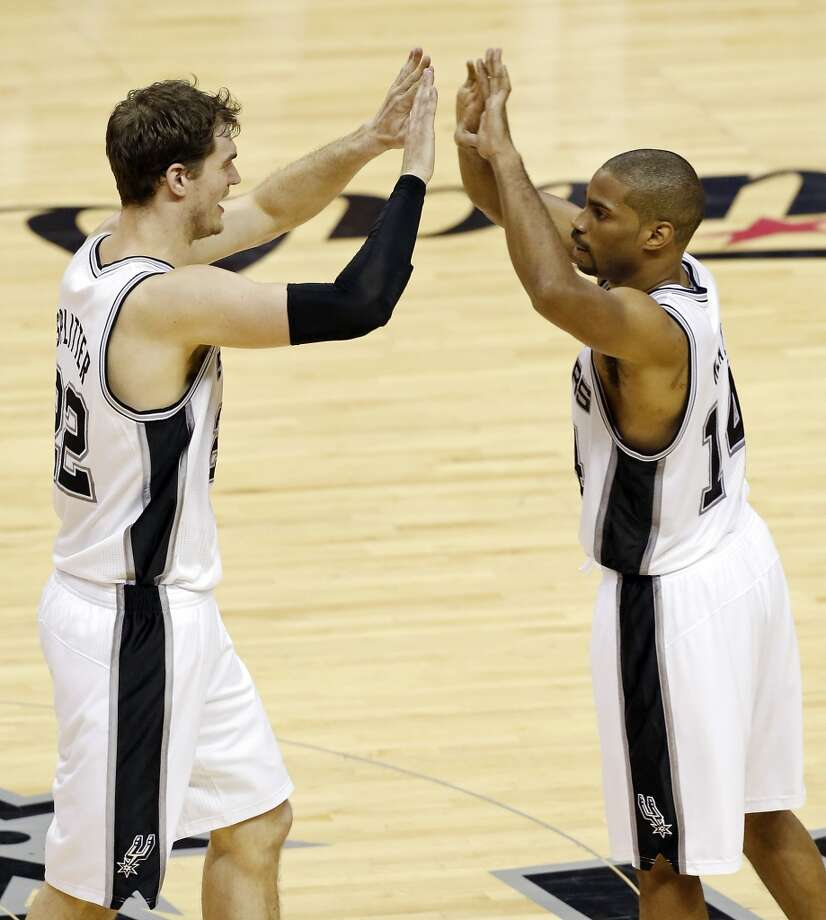 San Antonio Spurs' Tiago Splitter and San Antonio Spurs' Gary Neal celebrate after a play during the second half of Game 3 of the 2013 NBA Finals against the Miami Heat Tuesday June 11, 2013 at the AT&T Center. The Spurs won 113-77.
