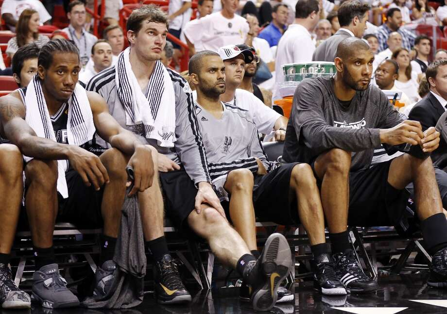 San Antonio Spurs' Kawhi Leonard (from left), San Antonio Spurs' Tiago Splitter, San Antonio Spurs' Tony Parker, and San Antonio Spurs' Tim Duncan sit dejected on the bench during second half action in Game 2 of the 2013 NBA Finals against the Miami Heat Sunday June 9, 2013 at American Airlines Arena in Miami, Fla. The Heat won 103-84.