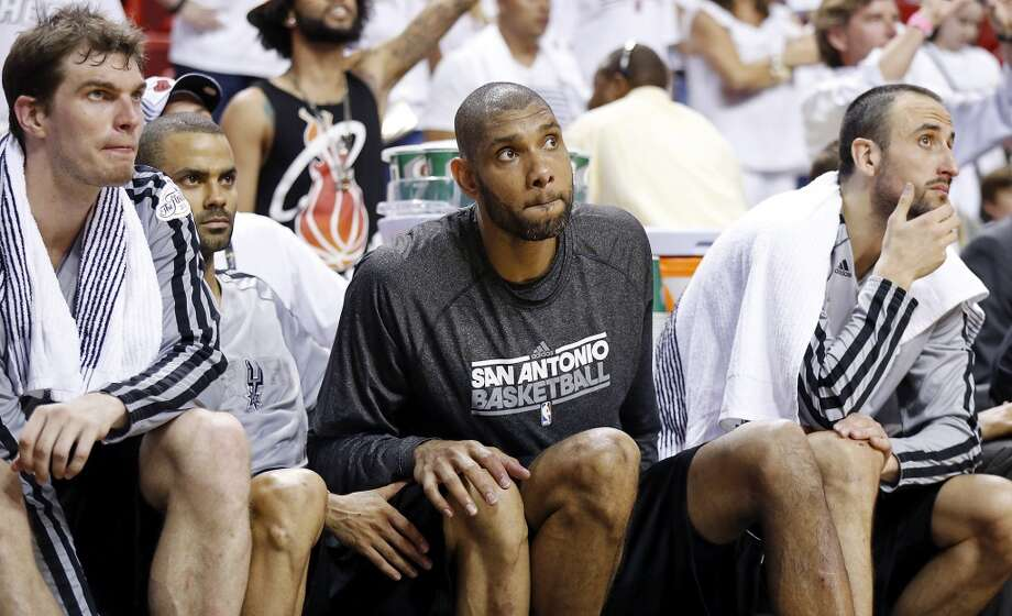 San Antonio Spurs' Tiago Splitter (from left), San Antonio Spurs' Tony Parker, San Antonio Spurs' Tim Duncan, and San Antonio Spurs' Manu Ginobili watch action from the bench during second half action in Game 2 of the 2013 NBA Finals against the Miami Heat Sunday June 9, 2013 at American Airlines Arena in Miami, Fla. The Heat won 103-84.