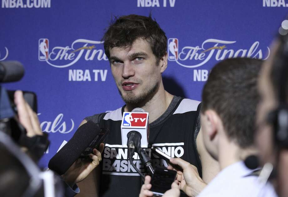 Tiago Splitter fields questions during practice and media sessions at the American Airlines Arena in Miami on Friday, June 7, 2013. (Kin Man Hui/San Antonio Express-News)