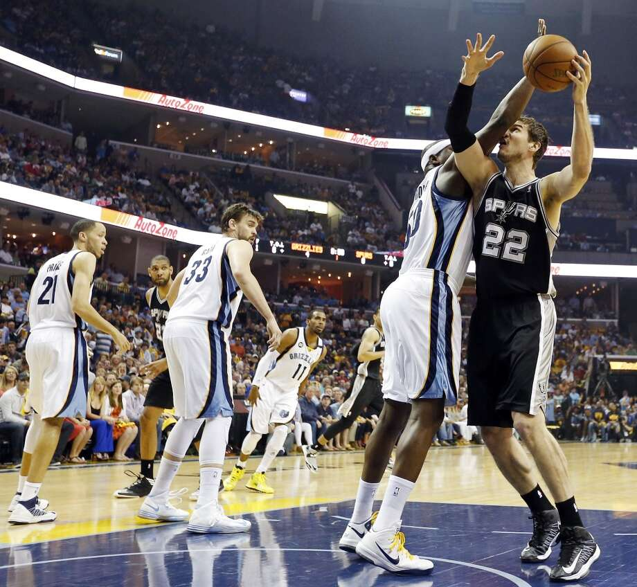 San Antonio Spurs' Tiago Splitter looks for room around Memphis Grizzlies' Zach Randolph during first half action in Game 4 of the 2013 Western Conference finals Monday May 27, 2013 at the FedEx Forum in Memphis, Tenn.