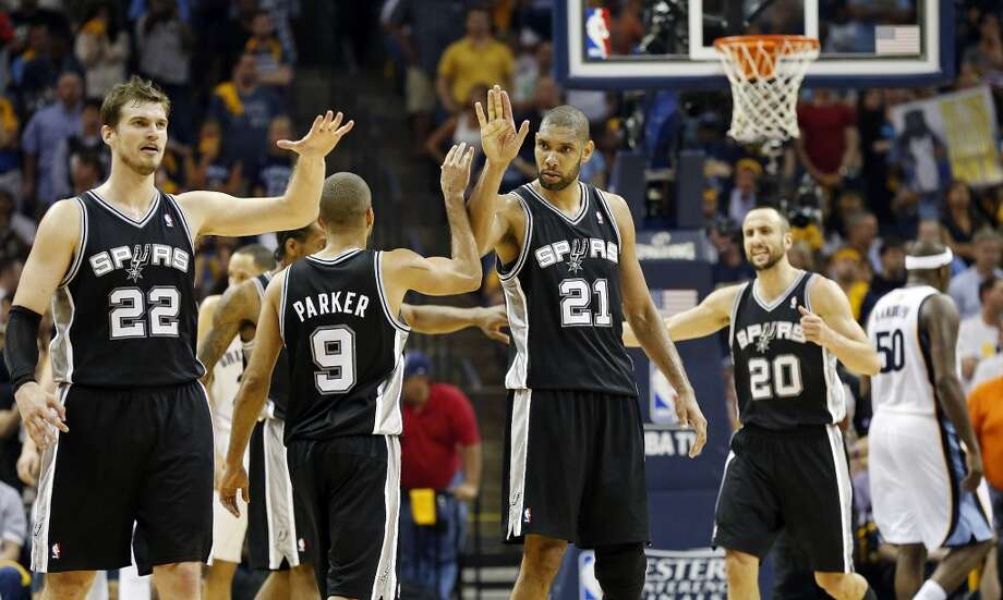 San Antonio Spurs' Tiago Splitter (from left) San Antonio Spurs' Tony Parker, San Antonio Spurs' Tim Duncan and San Antonio Spurs' Manu Ginobili react after Parker was fouled during overtime action in Game 3 of the 2013 Western Conference finals against the Memphis Grizzlies Saturday May 25, 2013 at the FedEx Forum in Memphis, Tenn. The Spurs won 104-93 in overtime.