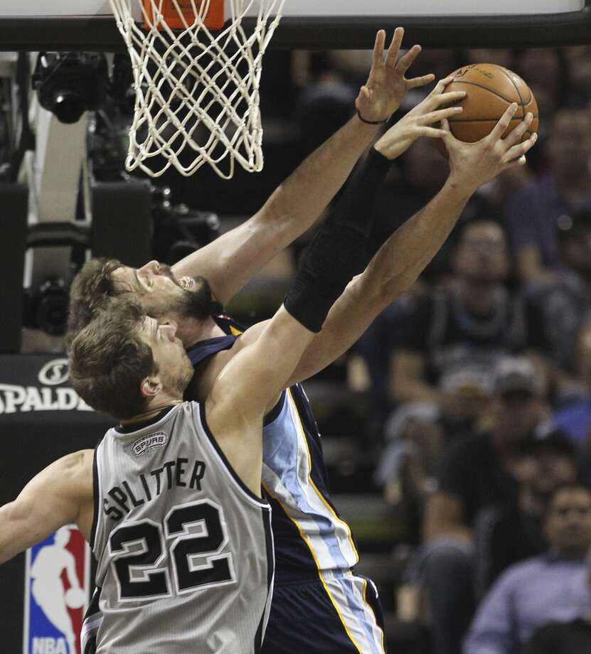 Spurs' Tiago Splitter (22) attempts a block against Memphis Grizzlies' Marc Gasol (33) in the first half of Game 2 of the 2013 Western Conference Finals at the AT&T Center on Tuesday, May 21, 2013. (Kin Man Hui/San Antonio Express-News)