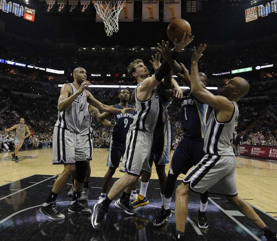 Spurs' Tiago Splitter (22), Tim Duncan (21) and Tony Parker (09) battles Memphis Grizzlies' Tony Wroten (01) for the rebound in the first half of Game 2 of the 2013 Western Conference Finals at the AT&T Center on Tuesday, May 21, 2013. Spurs won 93-89 in overtime. (Kin Man Hui/San Antonio Express-News)