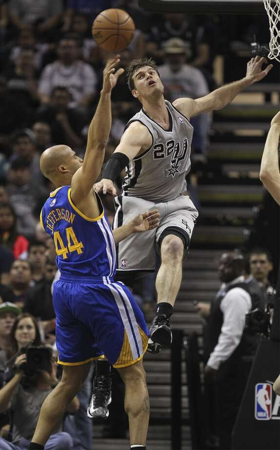 San Antonio Spurs' Tiago Splitter tries to block a shot by Golden State Warriors' Richard Jefferson during the first half of Game 5 in the NBA Western Conference semifinals at the AT&T Center, Tuesday, May 14, 2013.