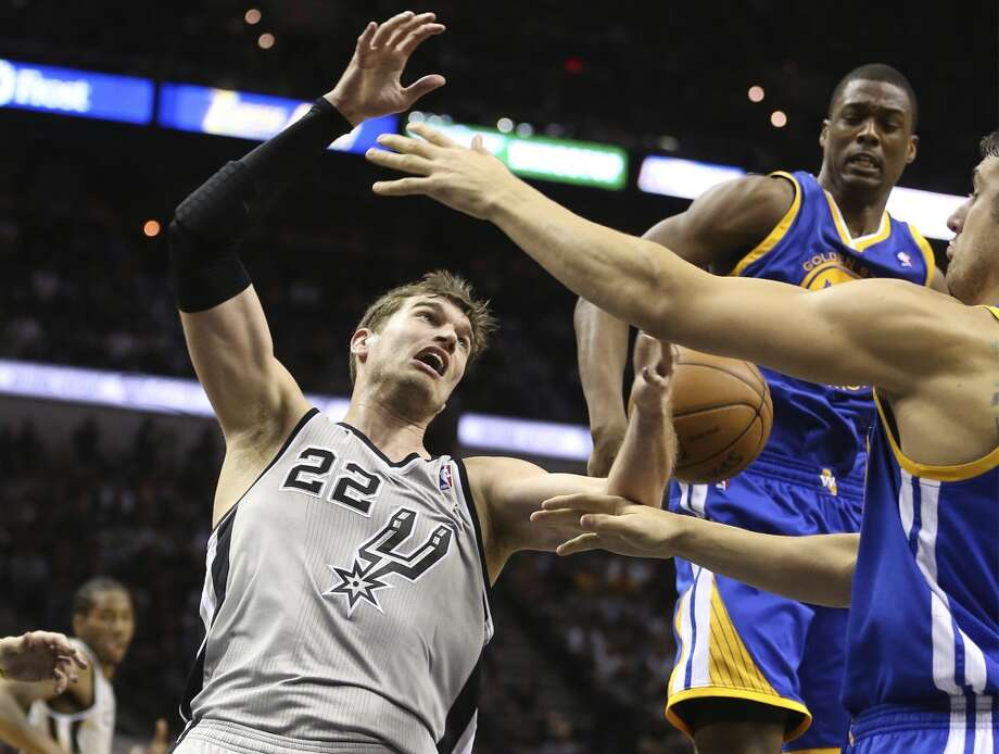 San Antonio Spurs' Tiago Splitter goes for a rebound against, Golden State Warriors' Harrison Barnes, back, and Andrew Bogut during the first half of Game 5 in the NBA Western Conference semifinals at the AT&T Center, Tuesday, May 14, 2013.