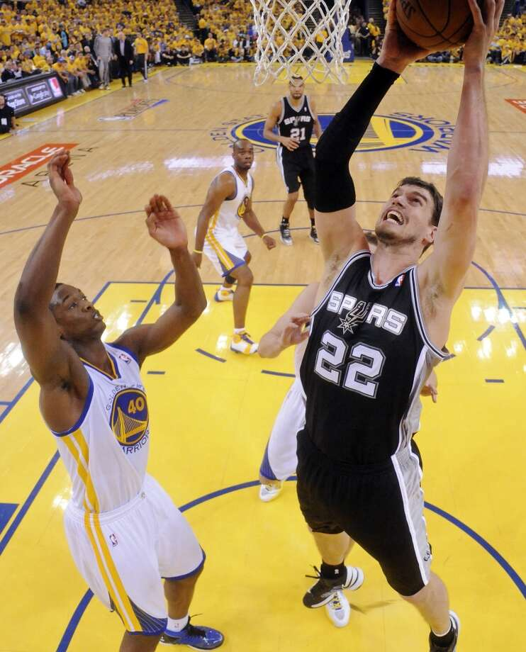 San Antonio Spurs' Tiago Splitter shoots around Golden State Warriors' Harrison Barnes during first half action of Game 3 in the NBA Western Conference semifinals Friday May 10, 2013 at Oracle Arena in Oakland, CA.